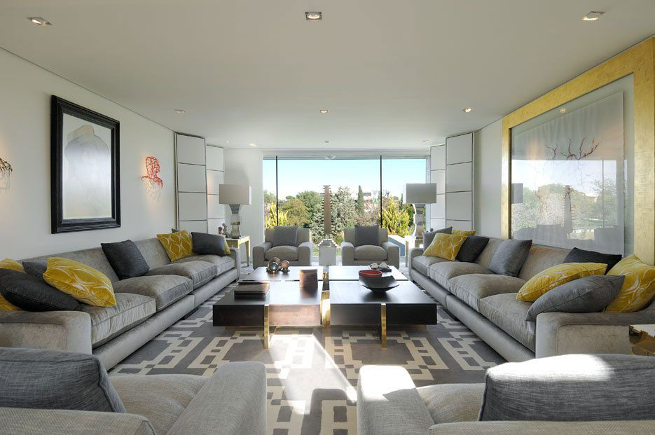 Lots Of Seating For A Long Living Room Layout Parallel Sofas Anchor The Decked Out In Black Grey Yellow And White Color Pallet