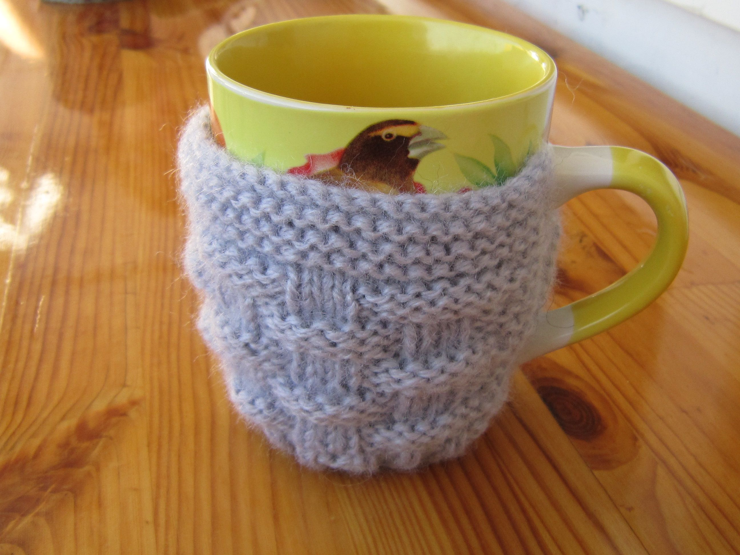 The gray coffee mug cozy is a great idea as kitchen gift