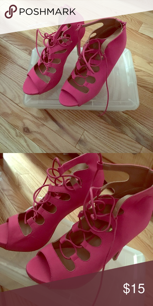 Hot pink Heels Lace up pink stilettos. Worn once. I think it fits more as a 10 1/2 Shoes Heels