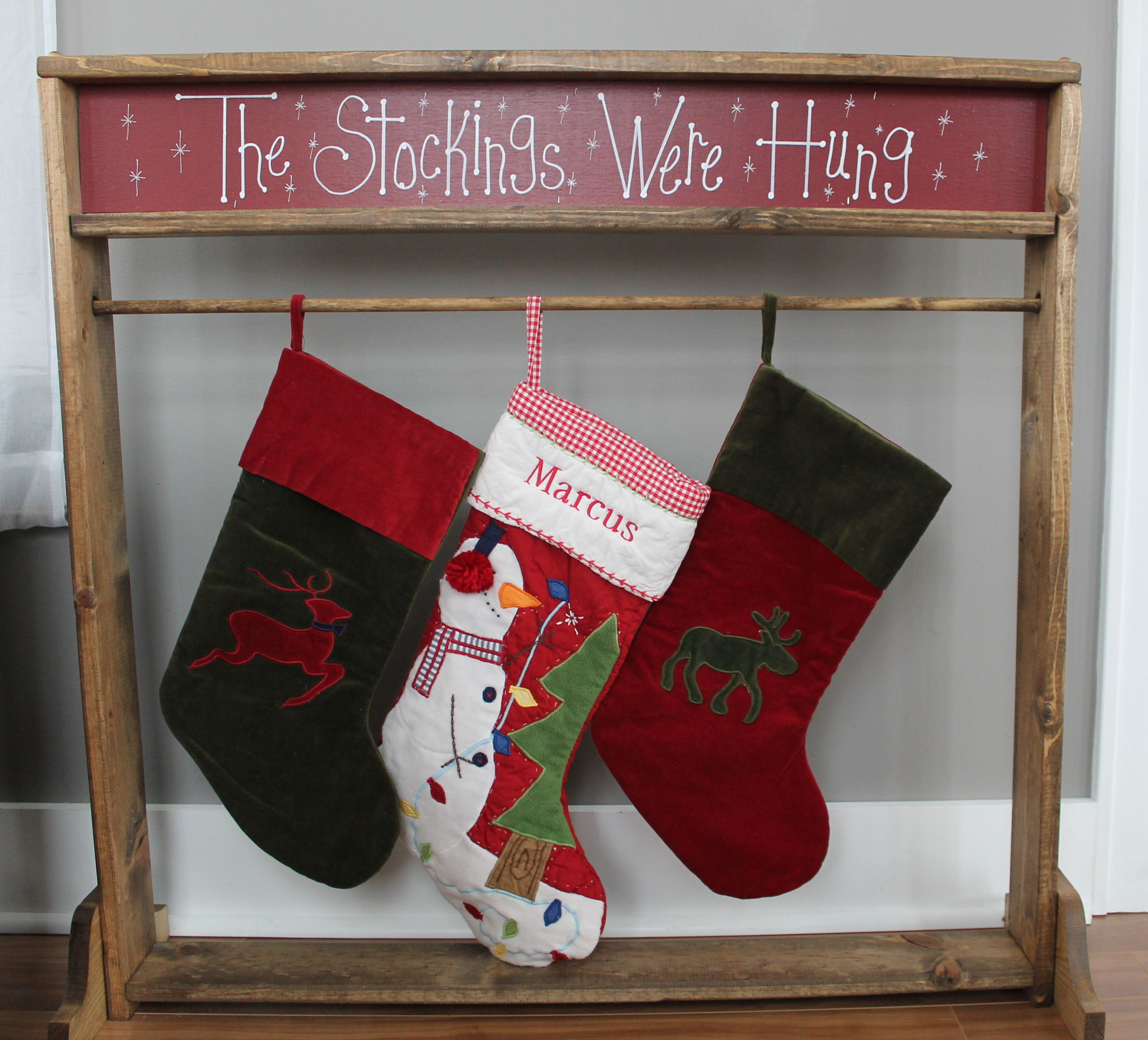 A wooden Christmas Stocking Stand. A great alternative to
