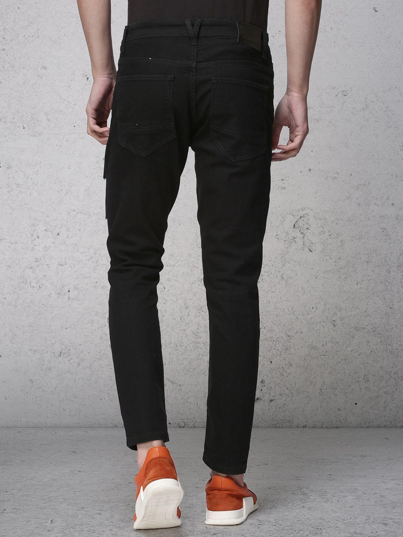 Men's grey flannel trousers  Buy Ecko Unltd Men Black Tapered Fit Mid Rise Clean Look Jeans