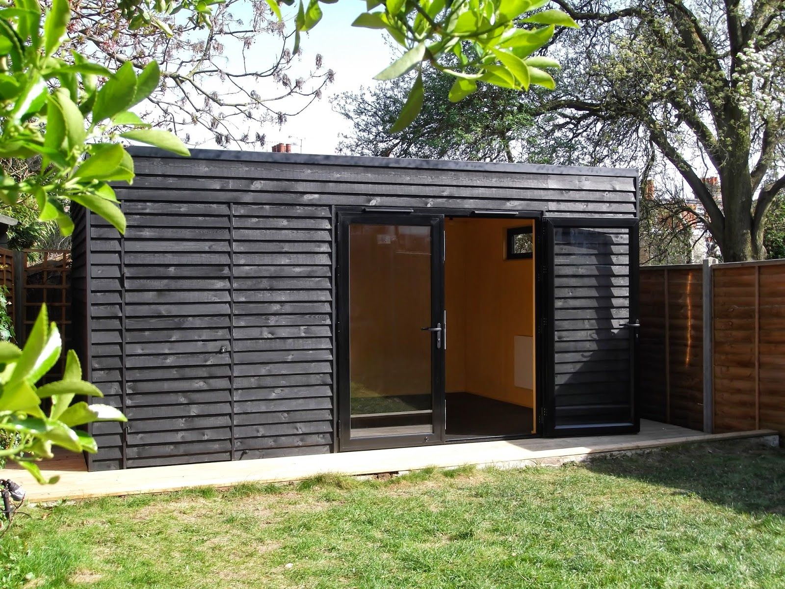 Garden room in crouch end with gym and storage black for Two room garden shed
