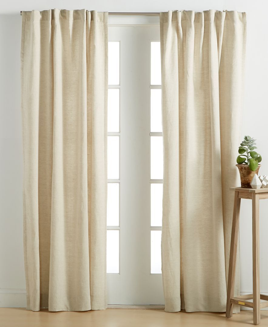 Bed against window with curtains  hotel collection linen natural