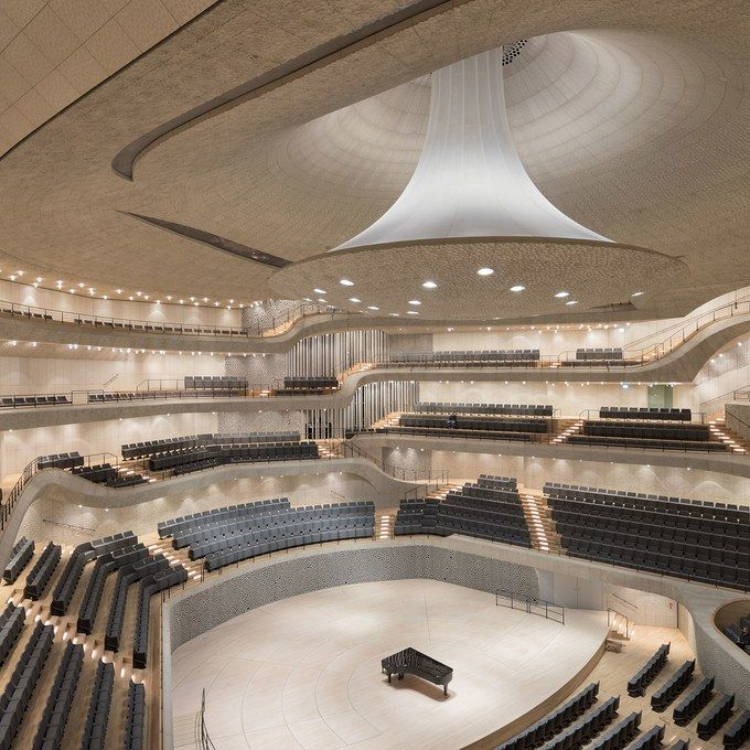 This Concert Hall Is Perched Atop One Of Hamburg S Largest Warehouse Buildings Concert Hall Elbphilharmonie Concert Hall Auditorium Design