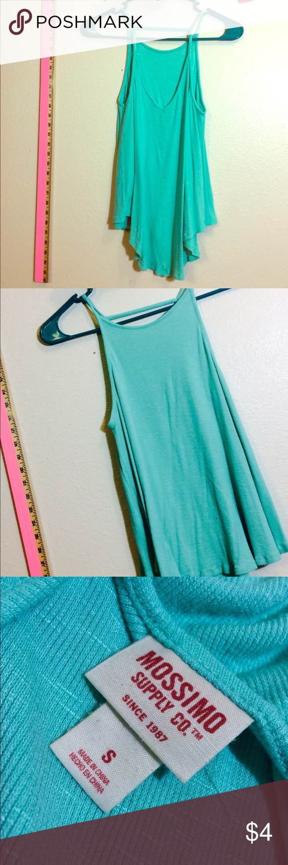 Target brand blue tank top Target brand tank with low cut back. Has small damage to a strap - fixable. Tops Tank Tops