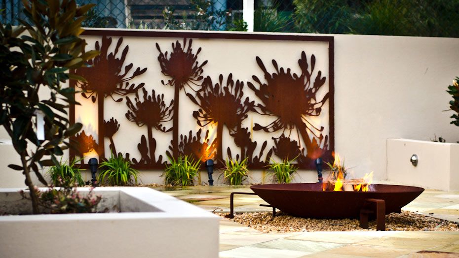 Love this laser cut screen used as a focal point on a for Garden fence features