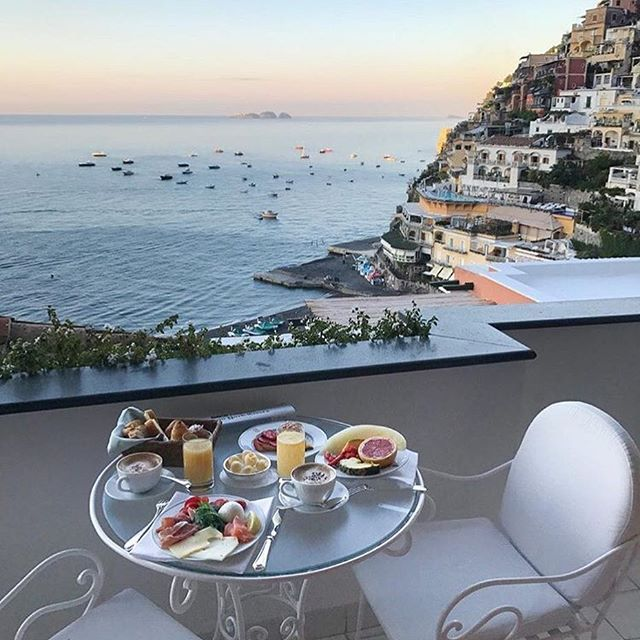 Photo of Dreaming of summer mornings and breakfast on the balcony. Watching Positano wake…