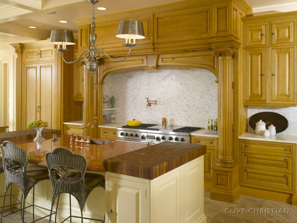 Antique Kitchens Island With Butcher Blocks On Ends And Sink In Middle Of Island
