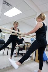 Series-Physical therapy, real situation. Woman works with pregnant therapist stock photo