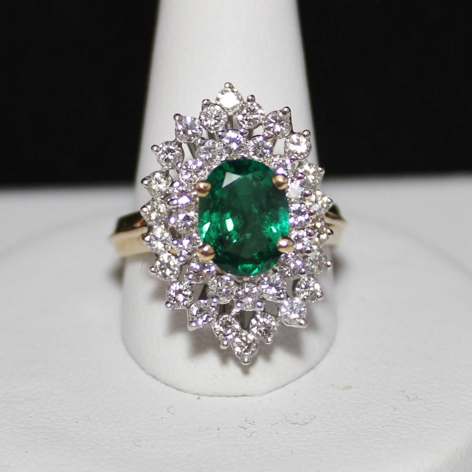 Offered today is a this absolutely elegant and gorgeous estate ring. It is an Emerald Diamond ring in 18k yellow gold with white gold prongs. The