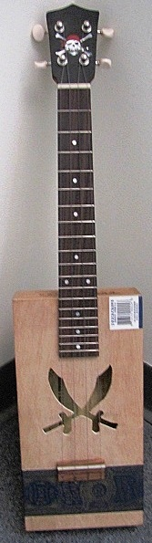 Steven Pollack of Yellow Rose Lutherie with a Pirate Cigar Box Ukulele --- https://www.pinterest.com/lardyfatboy/
