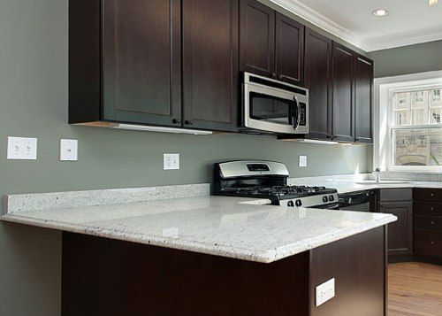 Dark Cabinets With White Granite Countertops White Granite Countertops White Countertops White Granite Kitchen