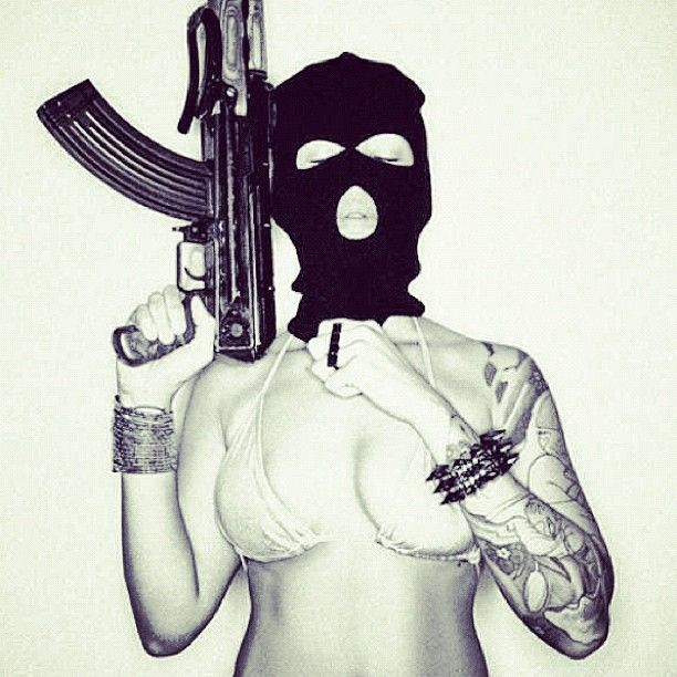 #crimeshit #girlswithtattoos #tattooedwomen #tattooed #blasted #instamood #clothingline #skimask #tattoos #guns