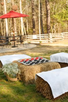 For a #farm wedding, display board games on haystack tables for guests! {@jamieblow}
