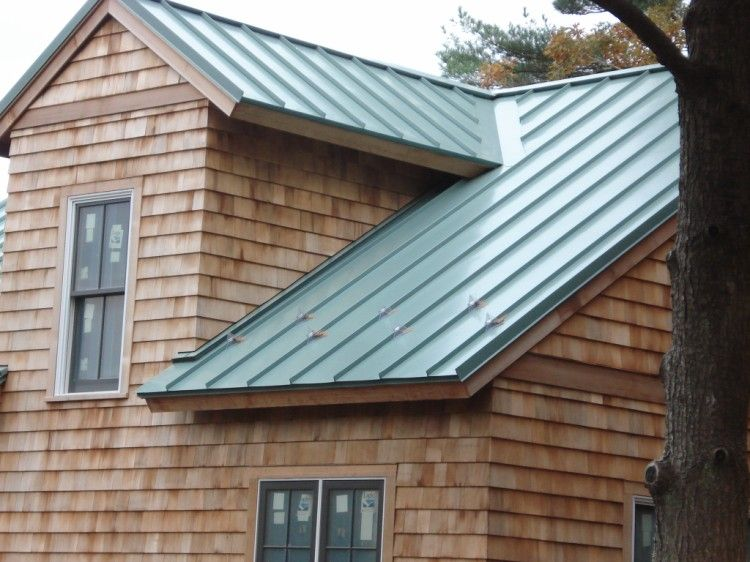 Green Standing Seam Metal Roof On A Residential Home.