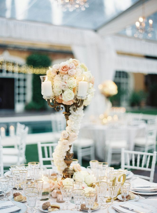 Glamorous floral wrapped tall centerpiece: http://www.stylemepretty.com/2016/04/07/an-italian-garden-wedding-fit-for-a-princess/   Photography: Judy Pak - http://judypak.com/