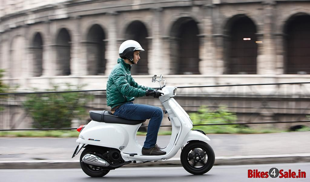 Picture Showing The Side View Of A Guy Riding The Vespa S 125