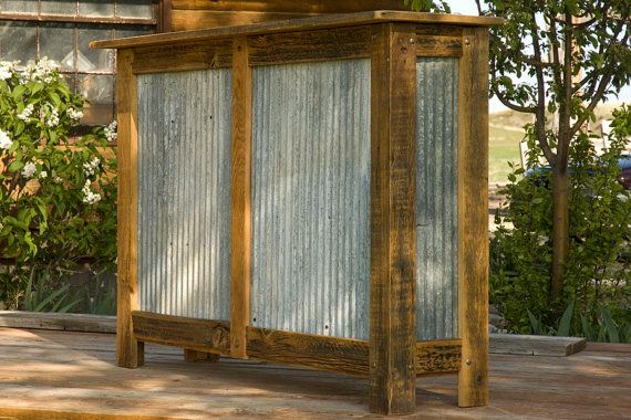 Dry bar or booth stand made from corrugated metal and rustic barnwood.