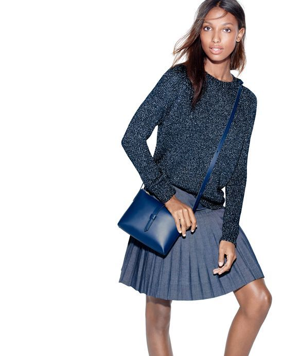 070c1d8c11 FEB '15 Style Guide: J.Crew women's metallic side slit sweater in sparkle  navy, pleated chambray mini skirt in indigo, Parker crossbody bag in navy.