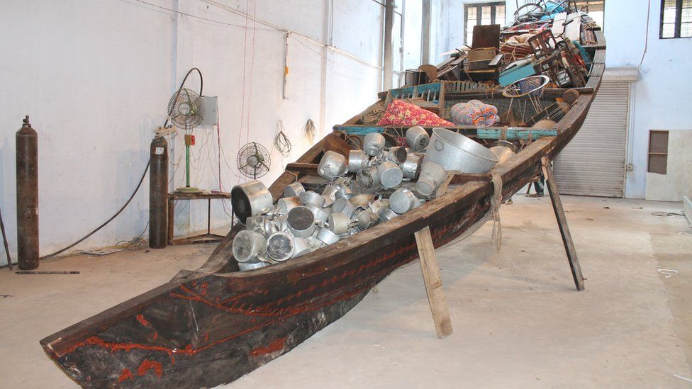 Art from the first Kochi Biennale in India. A Wooden Kerala style rice boat, filled with household goods by artist Subodh Gupta. See more here: http://m.bbc.co.uk/news/world-asia-india-20754902