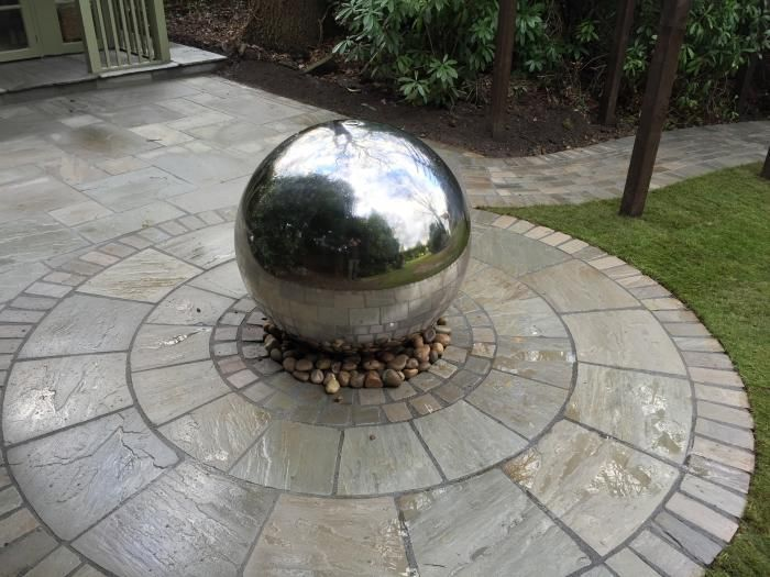 sandstone circles are great for breaking up large areas of square cut paving or for