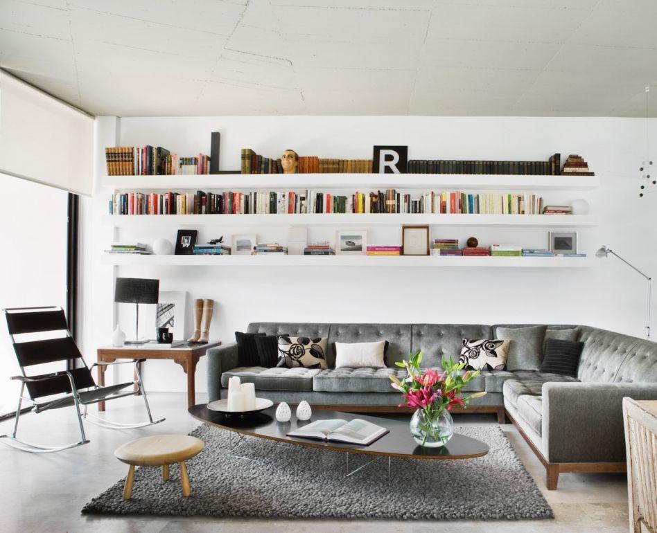 delightful white living room gray sofas suspended shelving | Long white bookshelves and gray couch/rug From Aaron De ...