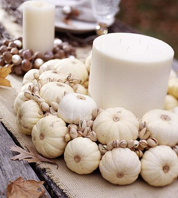 LOVE this centerpiece! Small white pumpkins and pistachios glued to a straw wreath