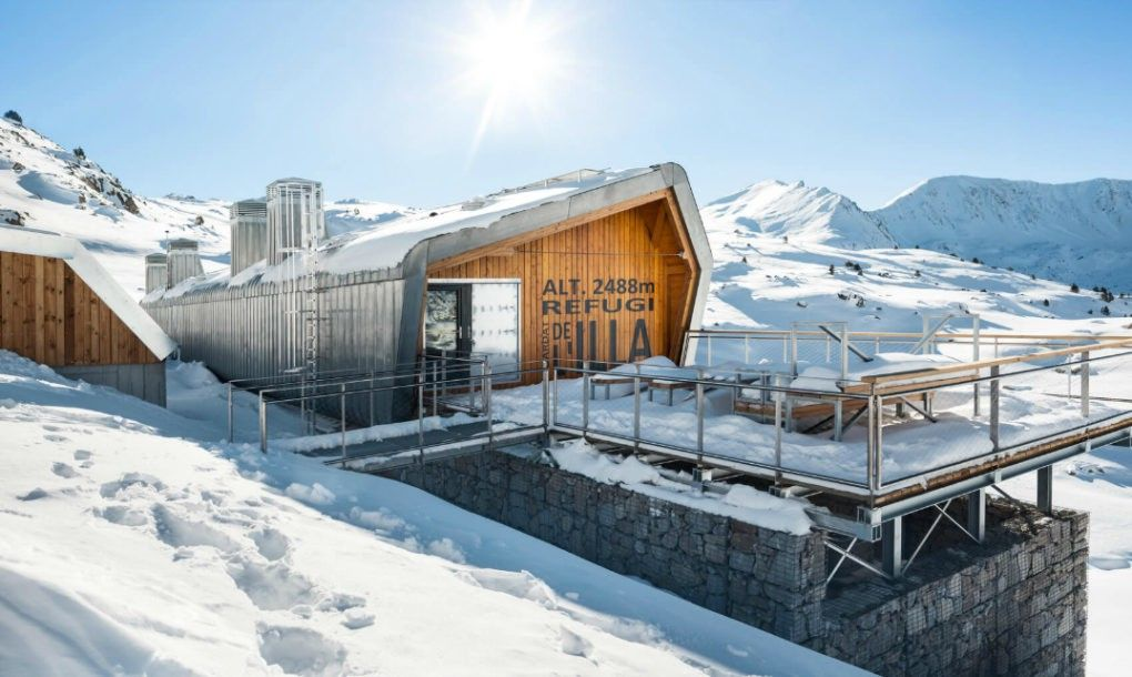 Architecture firms Arteks Arquitectura and Ginjaume Arquitectura i Paissatge partnered up to convert a 1930s mountain retreat into the modern, off-grid Illa Mountain Hut, which can generate up to four days of self-sufficient energy.