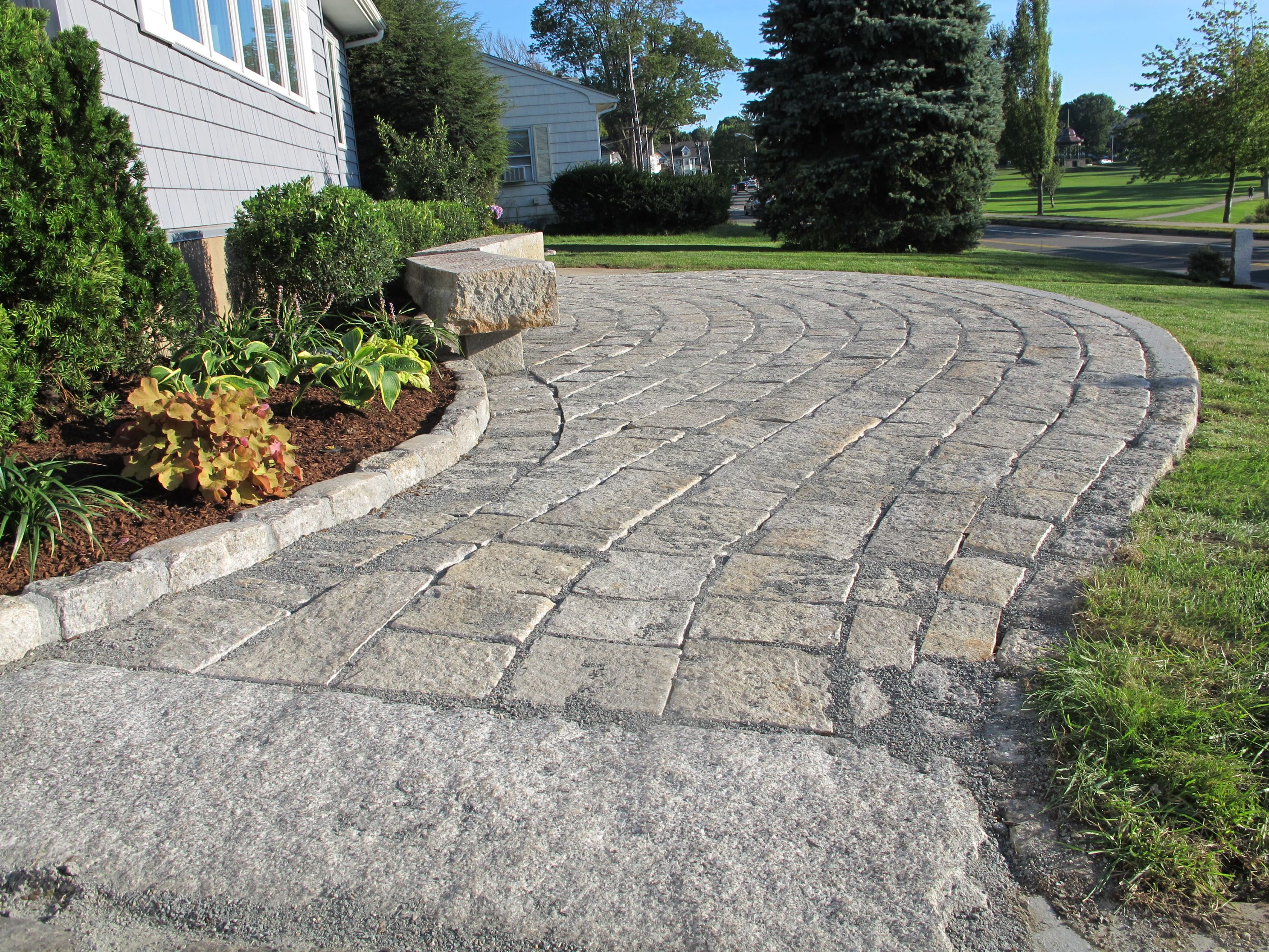 Reclaimed Granite Pavers And Cobblestone Edging Were Used In This Patio /walkway.