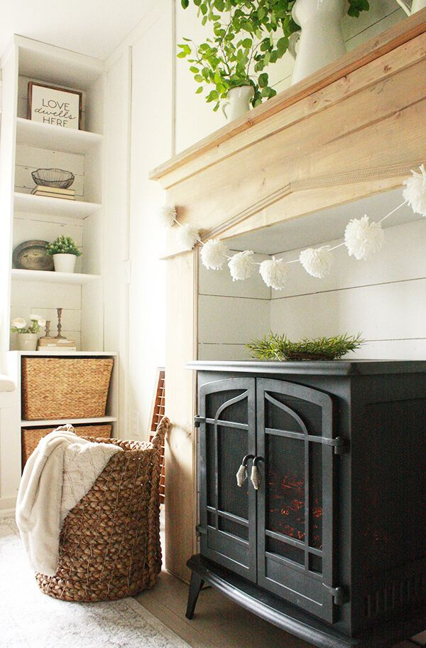 Some of my favorite farmhouse bedroom features include a cozy fireplace a comforting window seat faux beams farmhouse style lighting and so muc
