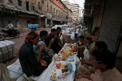 Ramadan In Karachi Labourers Break Fast Outside A Shop My Karachi In 2021 Ramadan Karachi The Outsiders