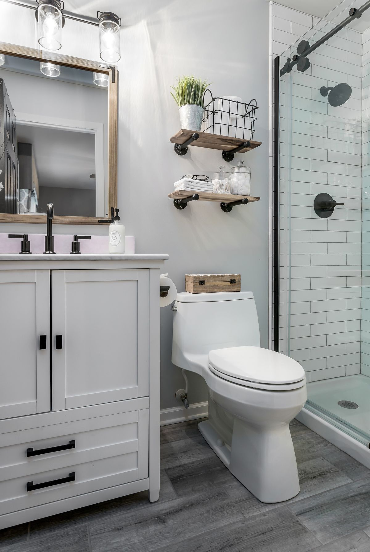 Would I Rather Have Grey Cabinets I Don T Know I Do Love The Hardware Dark G Guest Bathroom Remodel Bathroom Design Small Small Master Bathroom