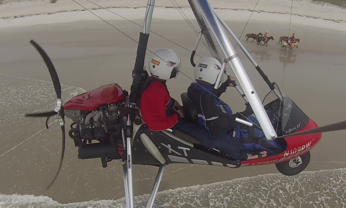 Will Stanwick getting a great birds-eye view of the horseback riders on the beach!  ---------------------------------- 877-WEDOFLY