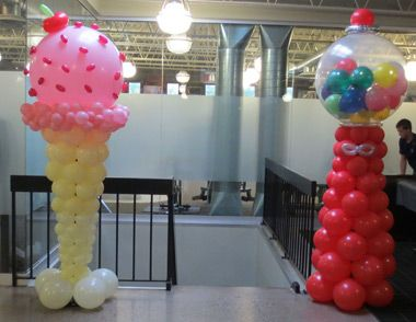 A larger than life ice cream cone and gumball machine make for Balloon decoration machine