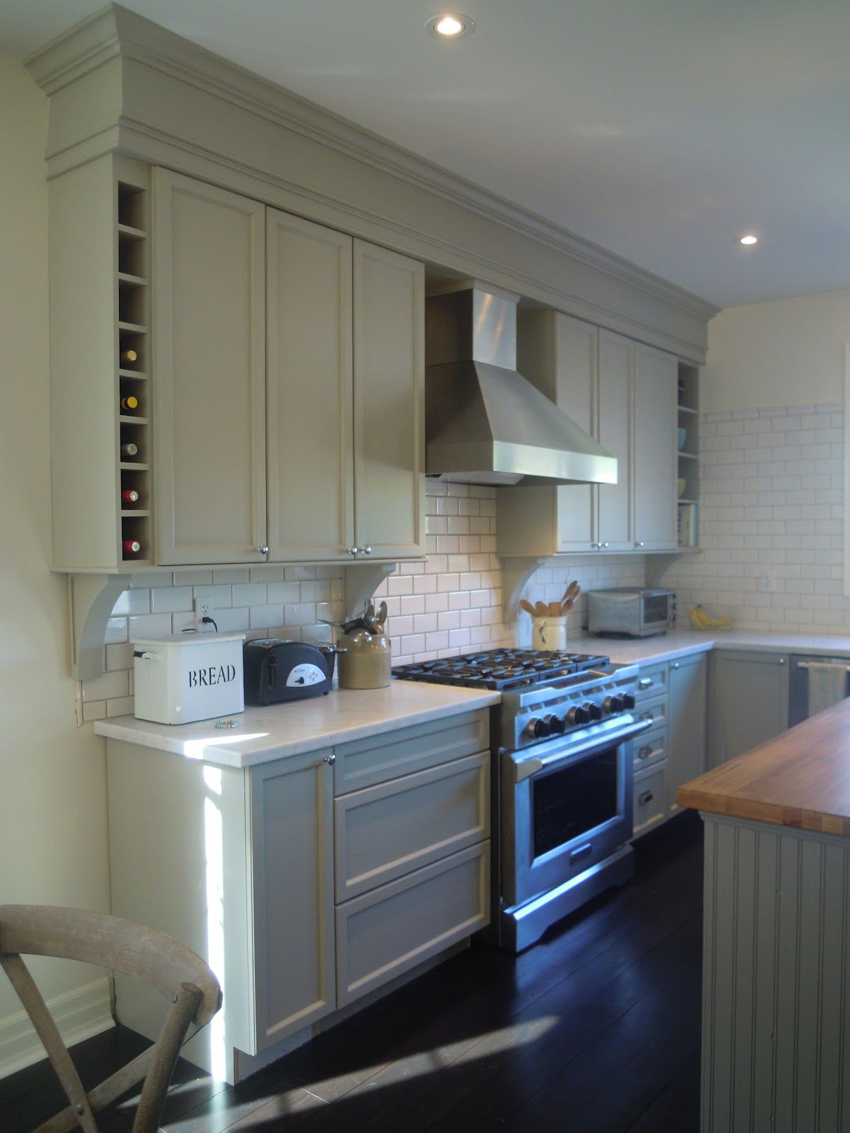 Mouldings crown moulding above kitchen cabinets to create the