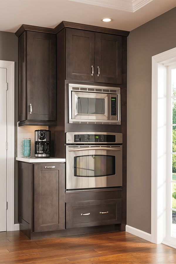 This tall microwave and oven cabinet follows the current for Kraftmaid microwave shelf