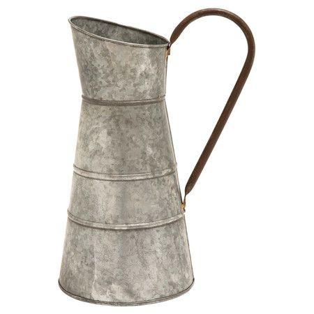 Galvanized metal watering jug.  Product: Watering jugConstruction Material: MetalColor: Antiqued...