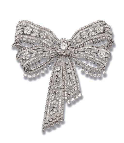 Black Flower Bow With Diamond: AN ELEGANT BELLE EPOQUE DIAMOND BOW BROOCH, BY CARTIER The