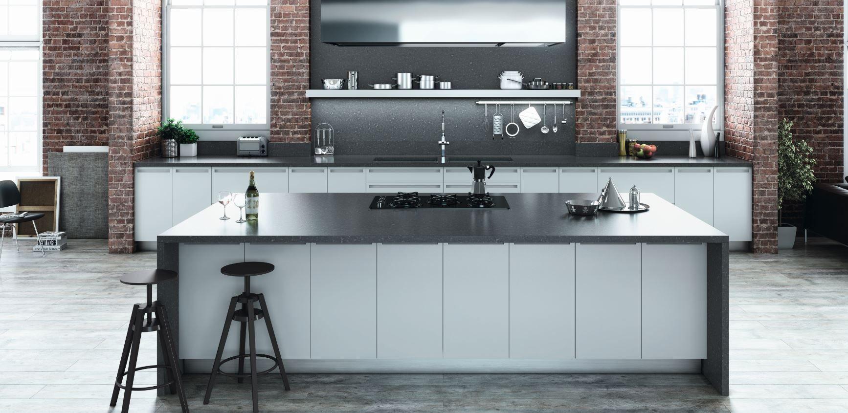 A modern industrial kitchen with a benchtop in essastone in bitumen ...