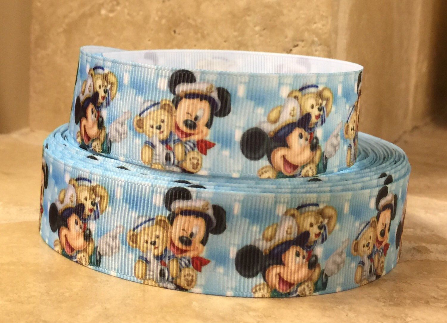 5 YDS Mickey Mouse w/ Duffy Ribbon by DCLRibbons on Etsy https://www.etsy.com/listing/236299457/5-yds-mickey-mouse-w-duffy-ribbon