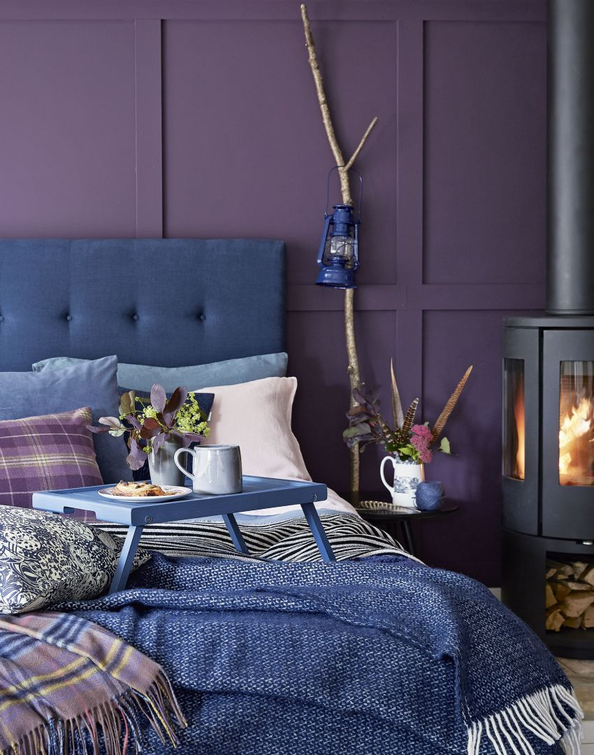Modern Purple Bedroom With Button Back Headboard And Blue