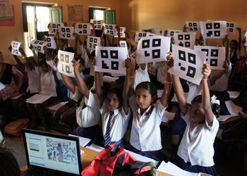 Indian school children respond to a classroom poll