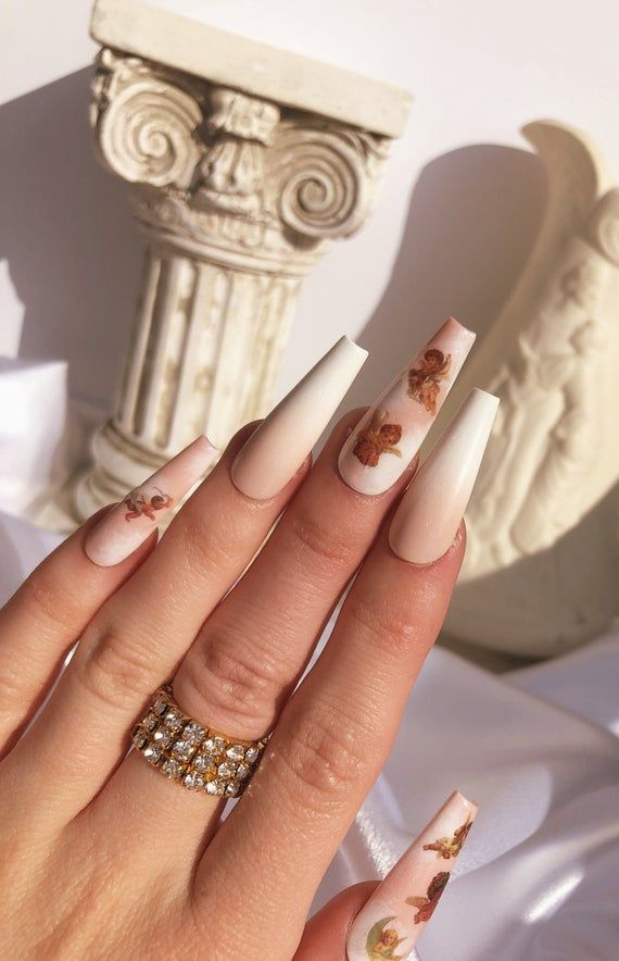 Angelic The Only Way To Describe This Gorgeous Nail Set Featuring Baby Cherub Nail Decals On Alternating In 2020 Coffin Nails Designs Angel Nails Long Acrylic Nails