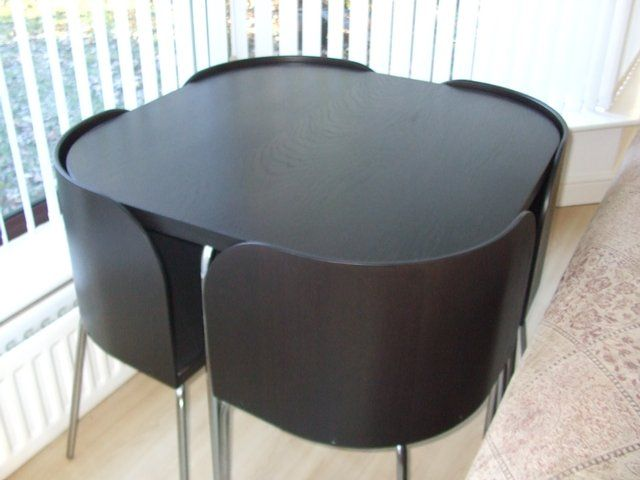 Ikea fusion dining table and chairs for sale this space saving table furniture pinterest - Space saving dining table ikea ...