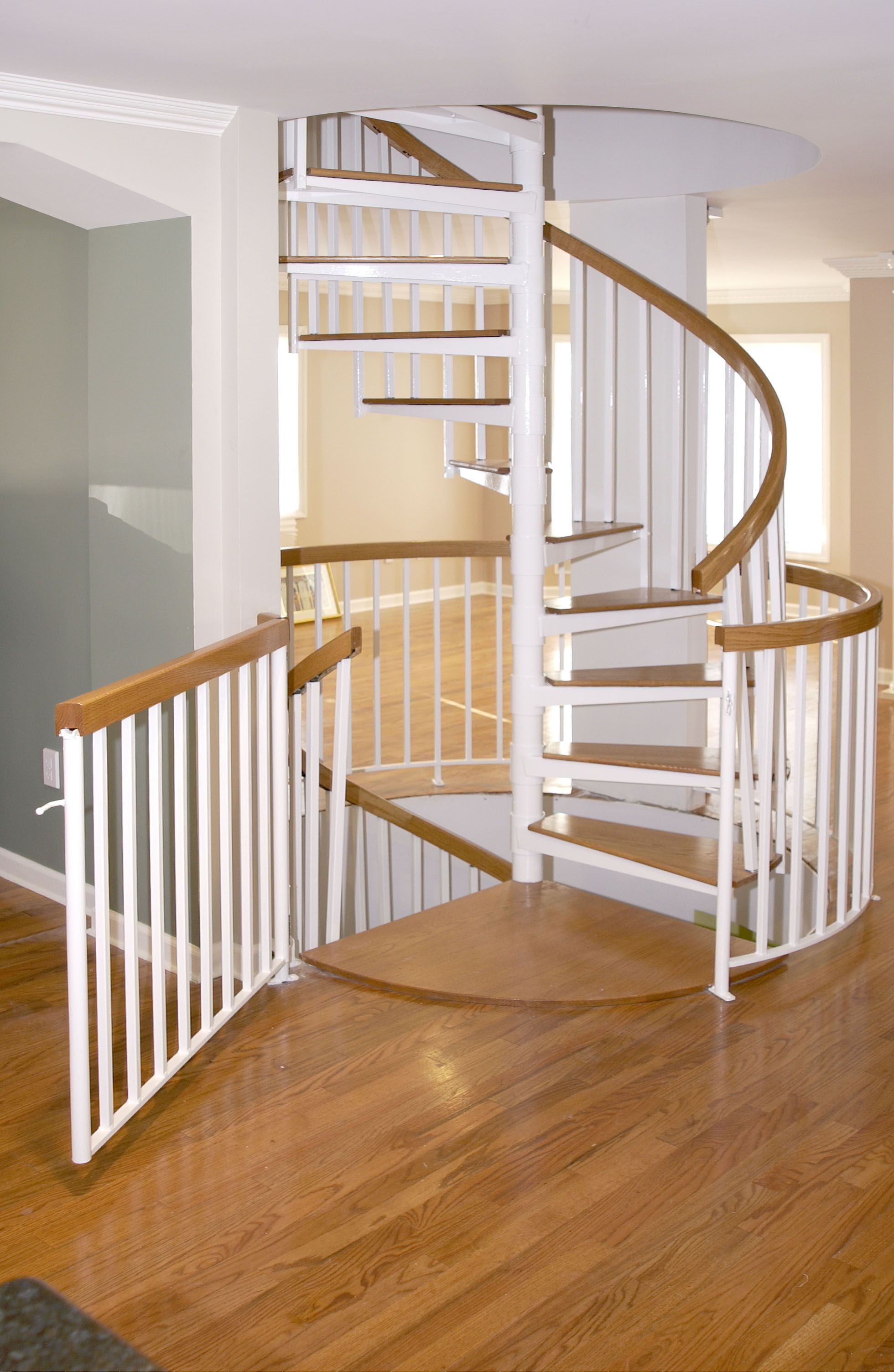 Best Residential Spiral Stair With Safety Gate Staircase 400 x 300