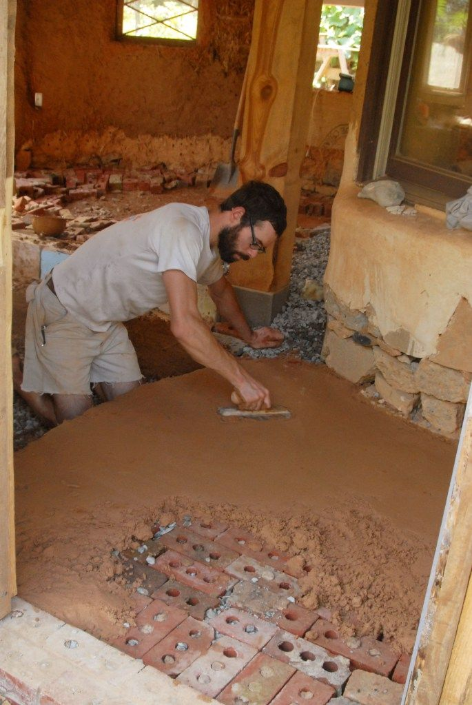 Use brick under earthen floor for thermal mass... clever