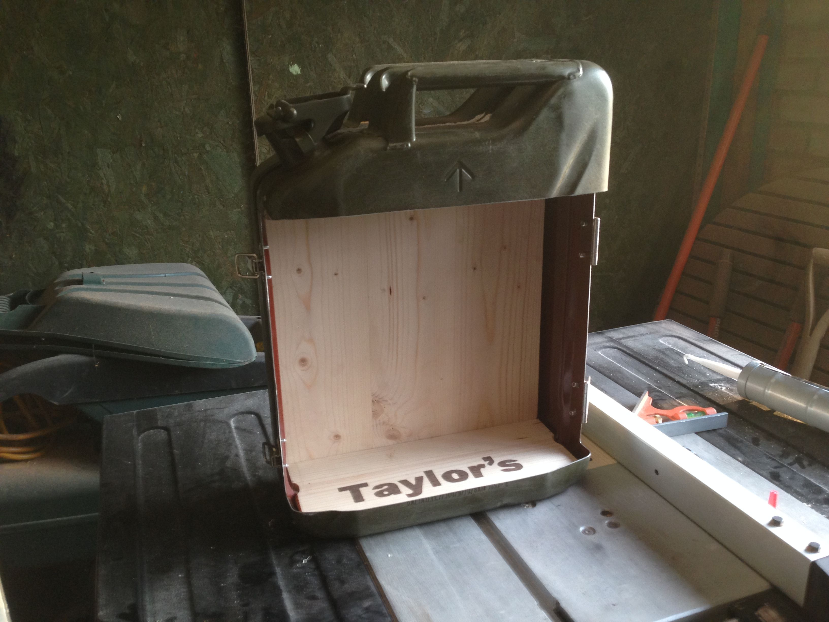I made this jerry can mini bar from a 1997 army jerry can. I backed ...