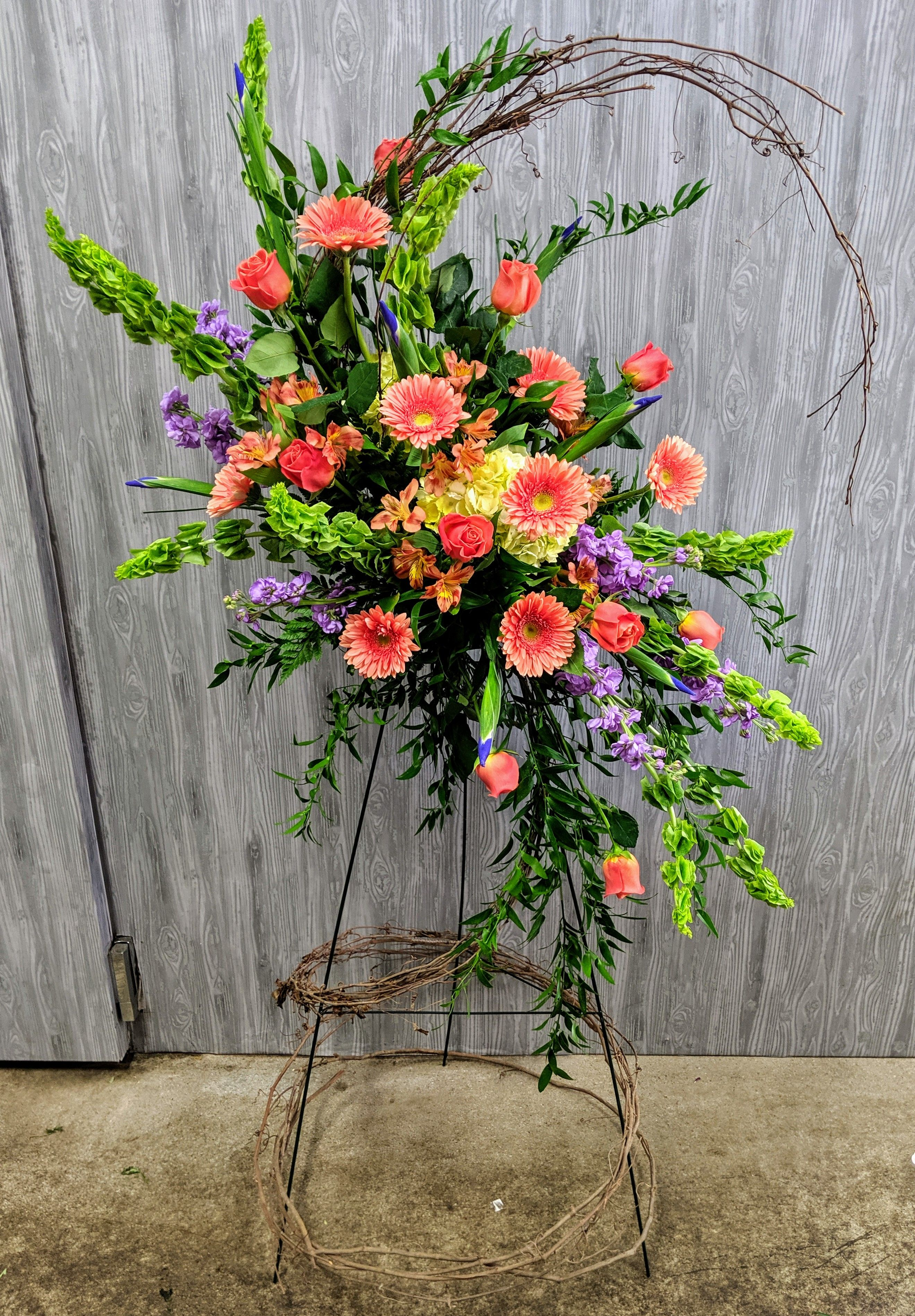 Standing Funeral Spray With Bells Of Ireland Roses Iris Lavender Stock And Gerbera Daisy Fresh Flower Delivery Funeral Sprays Flower Arrangements