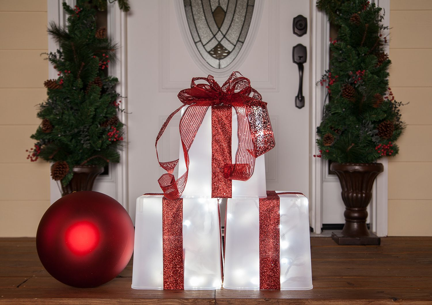 Lighted christmas gift boxes yard decor - Create A Lighted Gift Box Using A Plastic Container String Lights And Christmas Ribbons