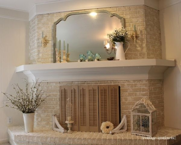 White Washed Brick Fireplace With White Wood Mantle By
